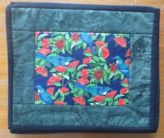 Tui in Pohutukawa Table Mats - set of 4