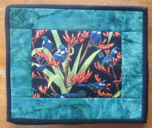 Tui in Flax Table Mats - set of 4